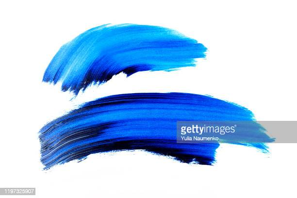 blue abstract painted ink strokes set on white paper, ink strokes. flat kind brush stroke. - farbklecks stock-fotos und bilder