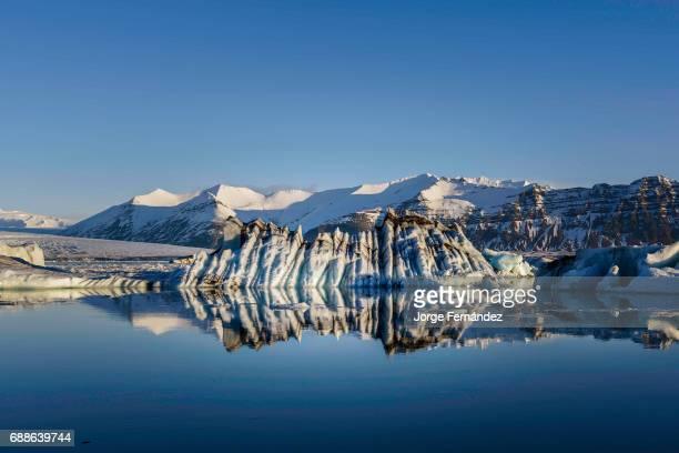 Blue and black icebergs floating on the Jokullsarlon glacial lagoon