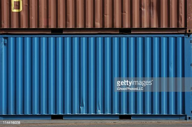 blue and brown cargo storage containers - container stock pictures, royalty-free photos & images