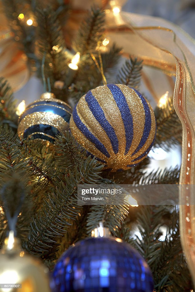 blue and gold christmas decoration on a christmas tree room for copy shot with