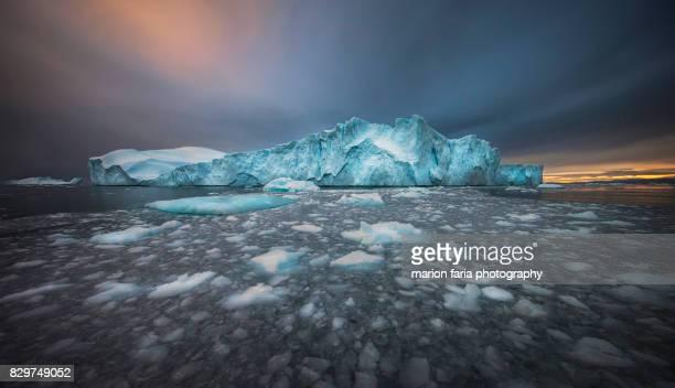 blue and gold - ilulissat stock-fotos und bilder