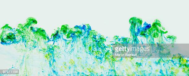 Blue and green ink suspended in water
