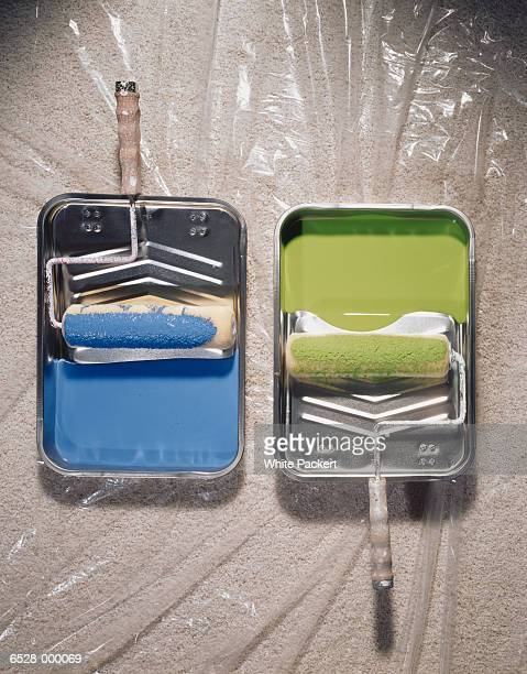 blue and green paint in trays - paint roller stock pictures, royalty-free photos & images