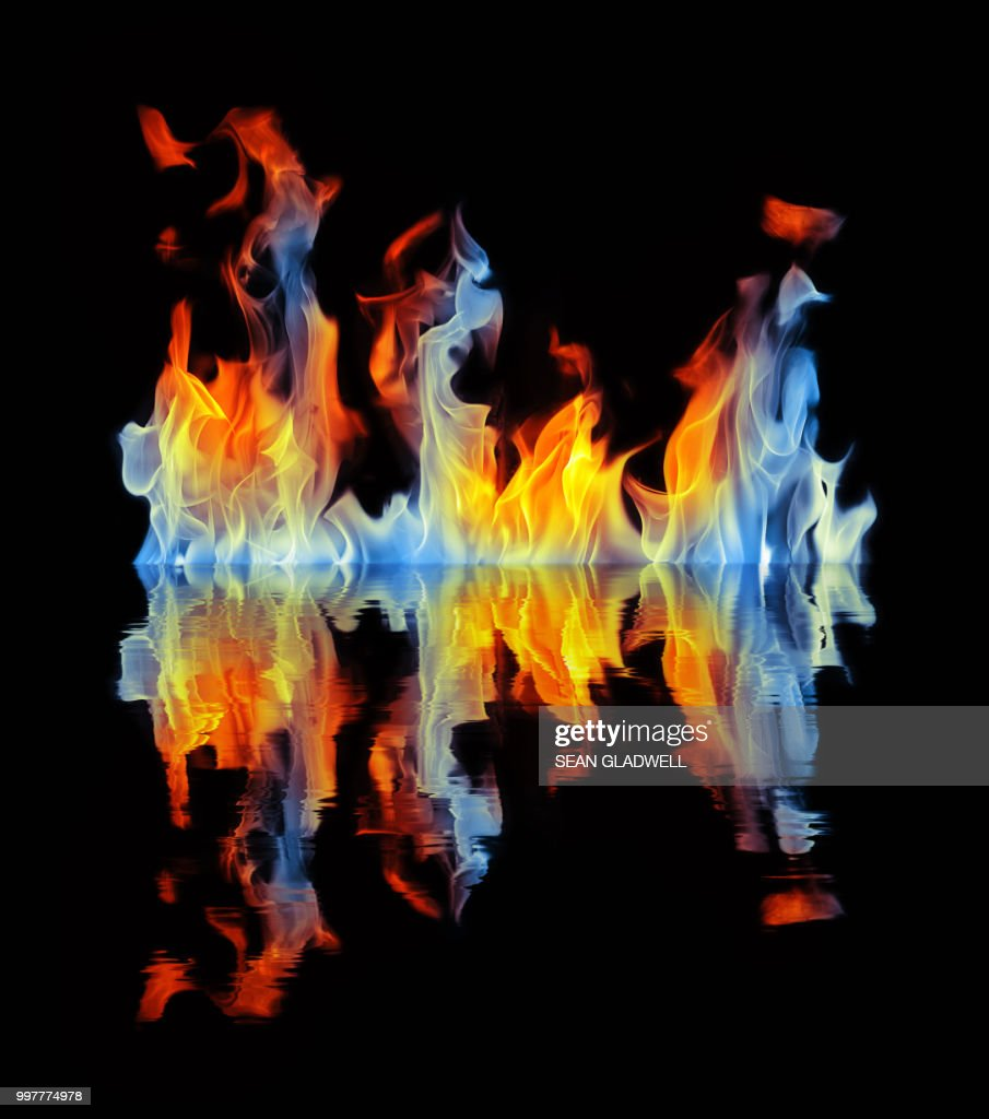 Blue and orange fire reflection : Stock Photo