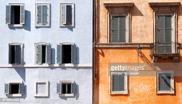 blue and orange row houses, campo dei fiori, rome, italy - cultura italiana foto e immagini stock