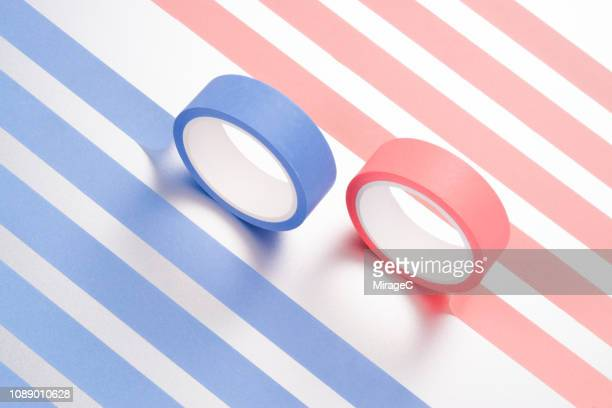 blue and pink adhesive tapes - クルクルと巻いた ストックフォトと画像