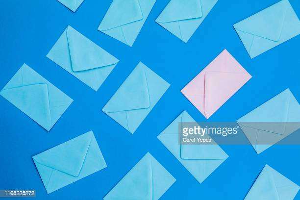 blue and pink  envelopes background.top view - envelope stock pictures, royalty-free photos & images