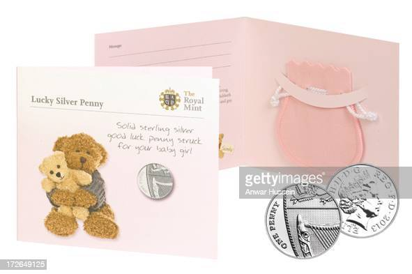 Blue and pink pouches inside a card decorated with teddies and the message 'Solid sterling silver good luck penny' are to be presented by the Royal...