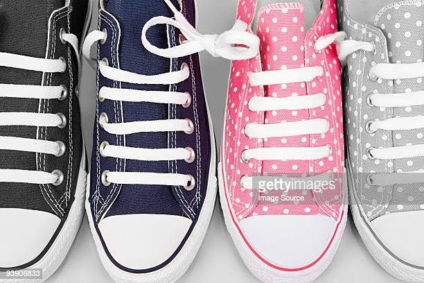 blue and pink sneakers - things that go together stock photos and pictures