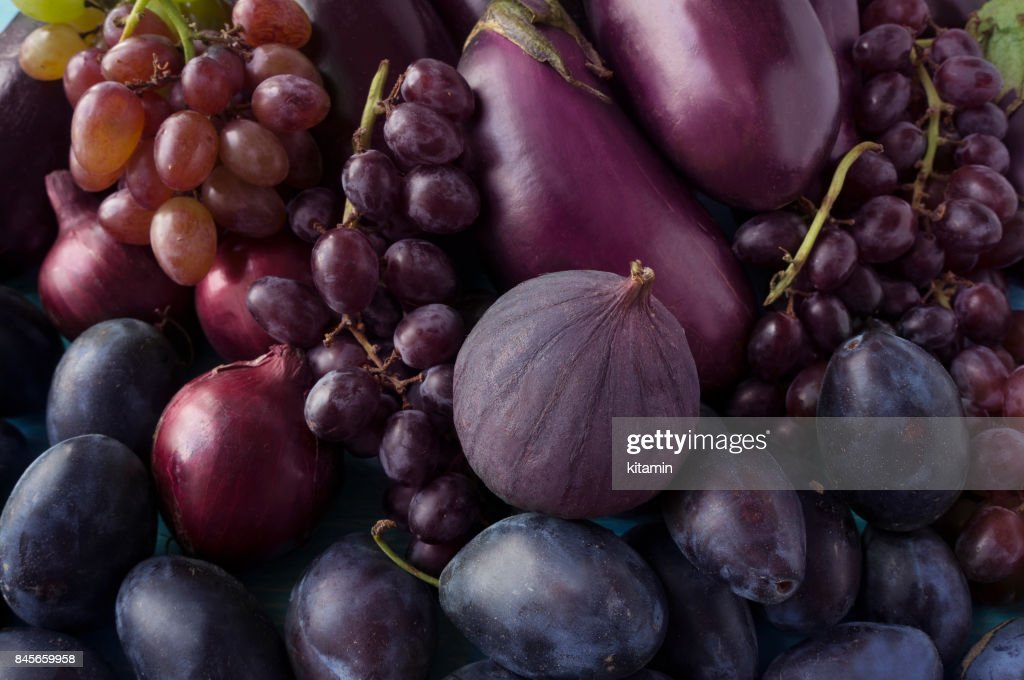 Blue and purple food. Background of fruits and vegetables.  Fresh figs, plums, onions, eggplant and grapes. Top view. : Stock Photo