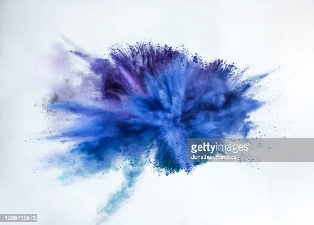 blue and purple powder explosion - white stock pictures, royalty-free photos & images