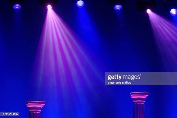 Blue and Purple Stage Lights with Two Roman Columns