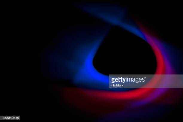Blue and red lights creating a sensual effect on a black background