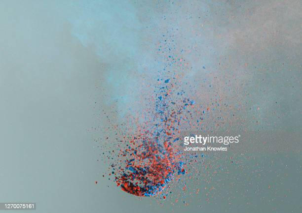 blue and red pigment exploding - physical structure stock pictures, royalty-free photos & images