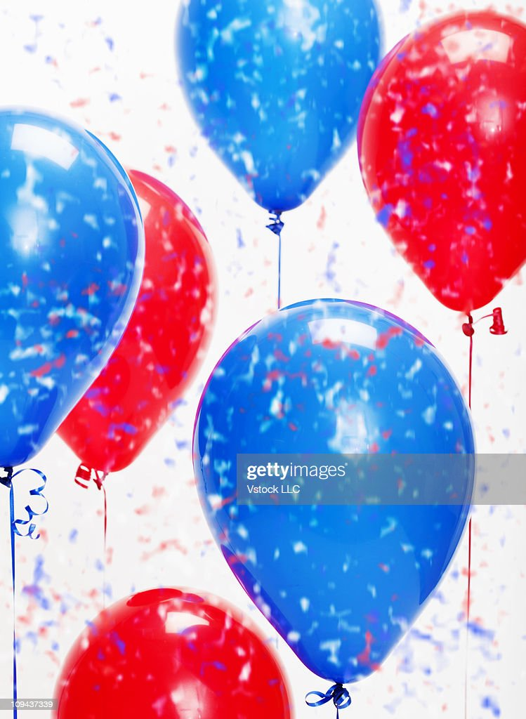 Blue and red political balloons with confetti : Stock Photo