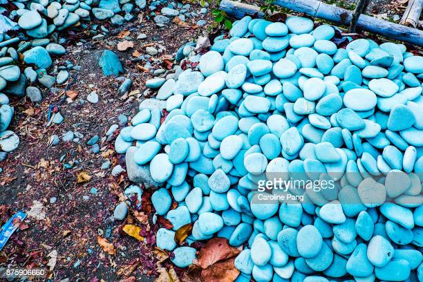 Blue and torquiose coloured stones on a stretch of beach along the road from Ende to Bajawa in Flores Indonesia.