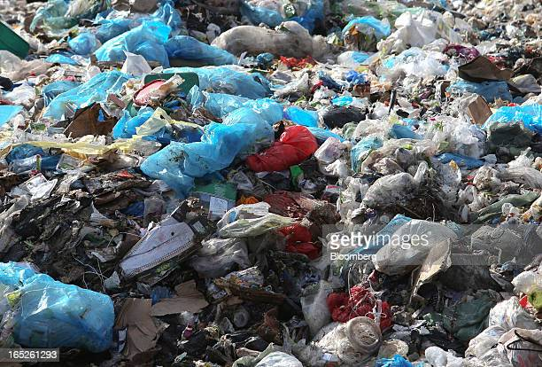 Blue and transparent plastic bags form part of the nonrecyclable rubbish on a landfill waste site operated by Biffa Group Ltd near Redhill UK on...