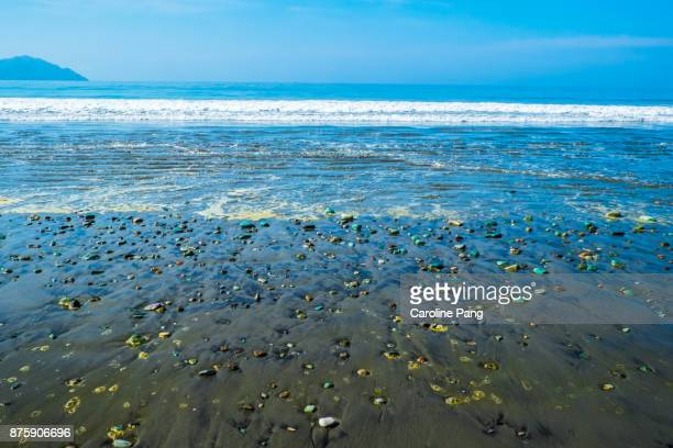 Blue and turquoise coloured stones are found on a stretch of beach along the road from Ende to Bajawa in Flores Indonesia.