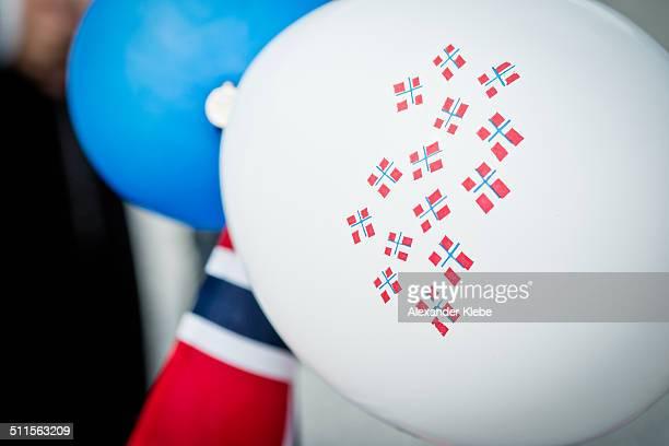 blue and white ballon with norwegian flag