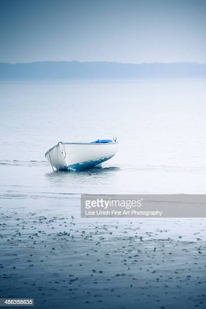 blue and white boat - lise ulrich stock pictures, royalty-free photos & images
