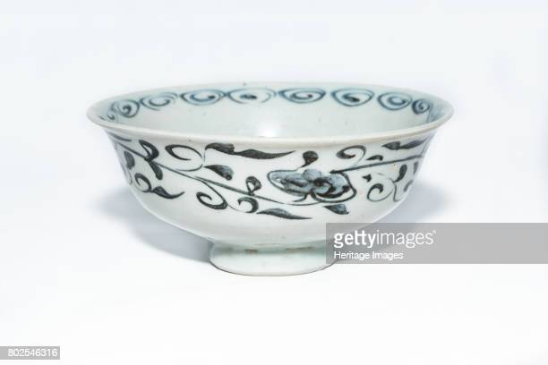 A blue and white bowl with moulded sixpetalled flower overpainted in underglaze blue in centre of interior The cavetto has moulded scrolling floral...