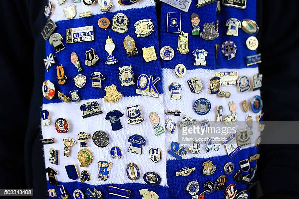 A blue and white Everton scarf adorned with pins and badges seen during the Barclays Premier League match between Everton and Leicester City at...