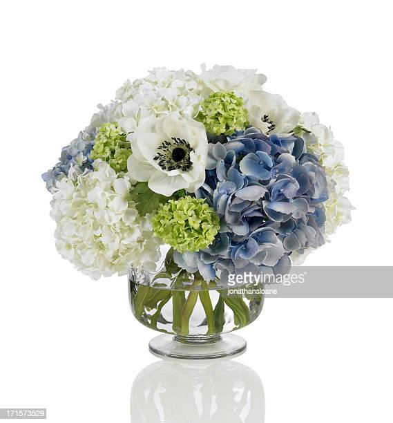 Blue and white hydrangea bouquet with poppies on white background