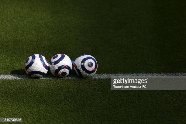Blue and white Nike Flight Premier League balls are seen lined up on the pitch prior to the Premier League match between Newcastle United and...