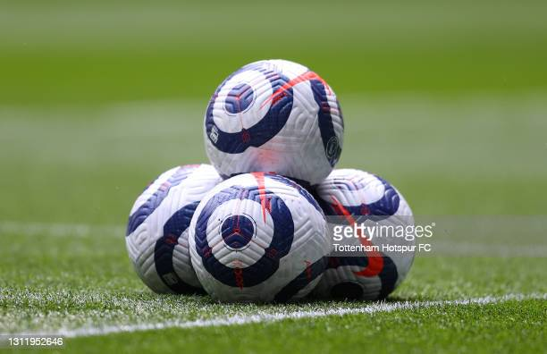 Blue and white Nike Flight Premier League balls are seen piled up on the pitch prior to the Premier League match between Tottenham Hotspur and...