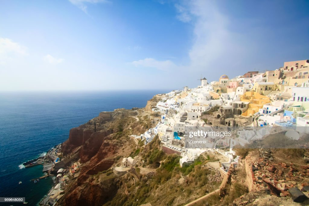 A blue and white Oia village with a windmill at the cliff look out to Aegean sea on Santorini island, Mediterranean, Greece : Stock-Foto