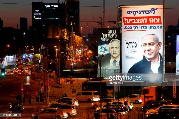 Blue and White political alliance electoral billboard shows the portrait of retired general Benny Gantz , one of the leaders of the Blue and White,...