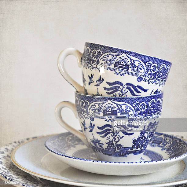 blue and white stacked china tea cups - porcelain stock photos and pictures