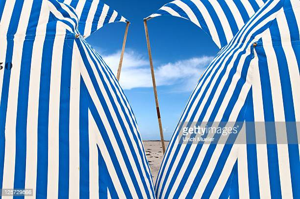 blue and white tents on beach - dinard stock pictures, royalty-free photos & images