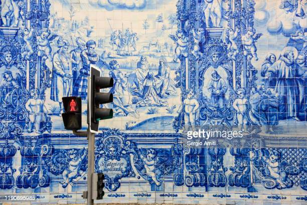 blue and white tiles of chapel of souls in porto - traditionally portuguese stock pictures, royalty-free photos & images