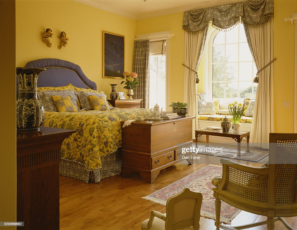 Blue And Yellow Accents In Bedroom : Stock Photo