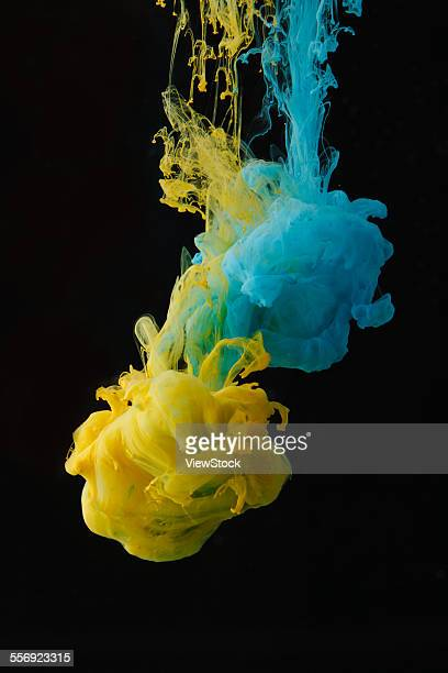 Blue and yellow ink in the water