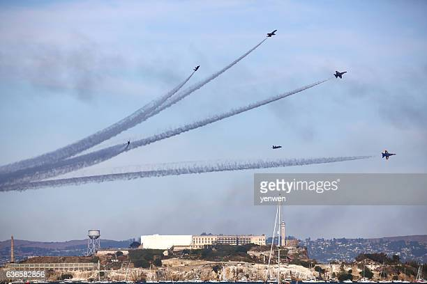 blue angels airshow above alcatraz island - fleet week stock photos and pictures
