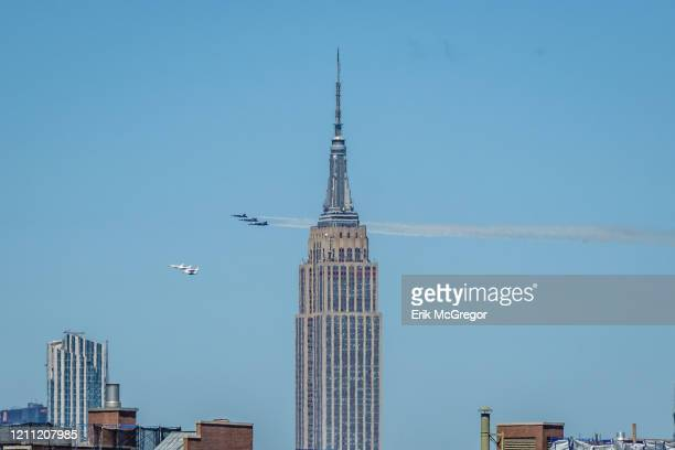 Blue Angels and Thunderbirds fly over the Empire State Building The Navy Blue Angels and Air Force Thunderbirds performed a fly over New York City to...