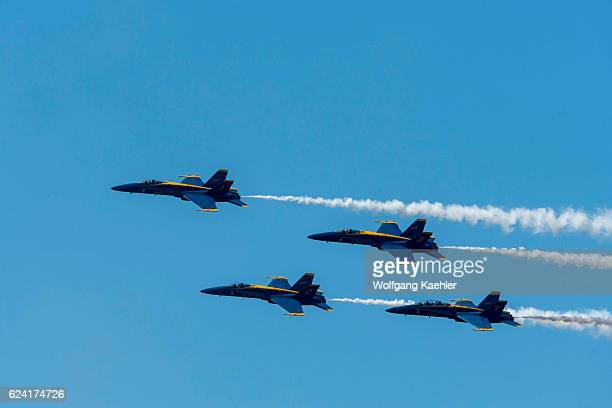 Blue Angels F/A18 Hornets are flying The Diamond Roll doing a 360degree roll as one unit flying at 400 mph over Lake Washington for the Seafair...