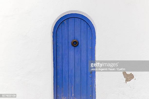 blue arch doorway of house - door knocker stock photos and pictures