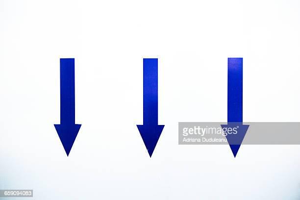 Blue Arrow Symbols On White Door