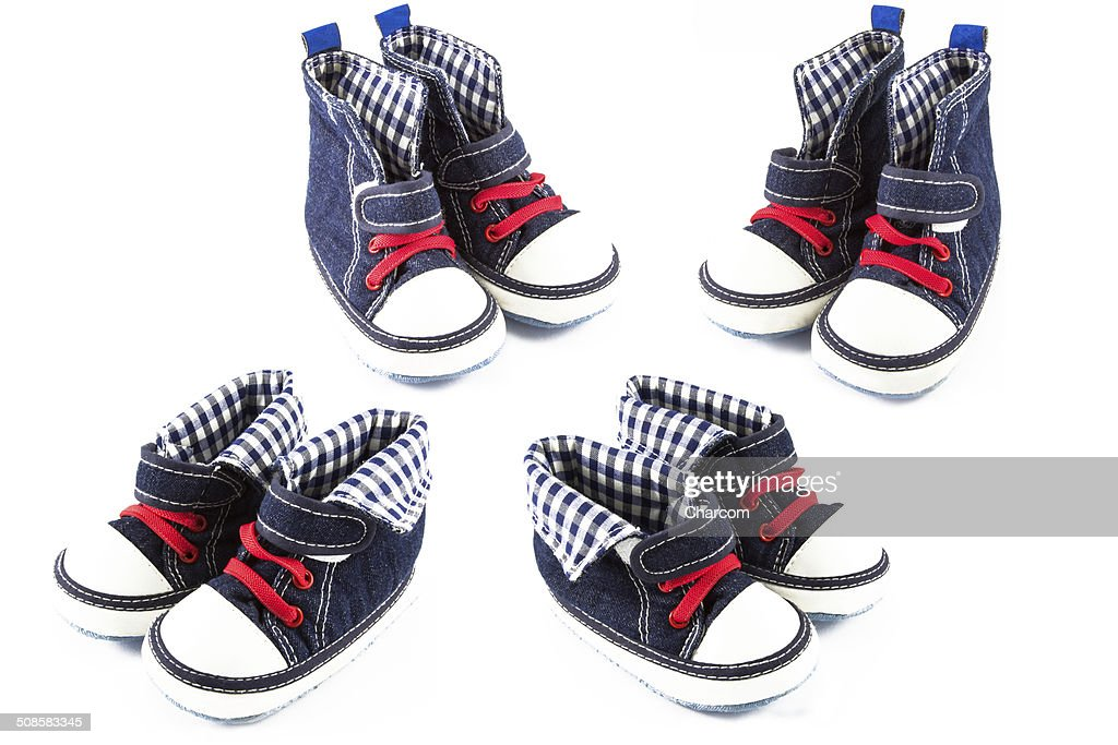 b79f3bc20 Blue Baby Shoes Isolated On White Background Stock Photo - Getty Images