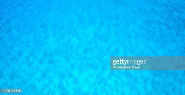 blue background of ocean, top view. - 浅い ストックフォトと画像