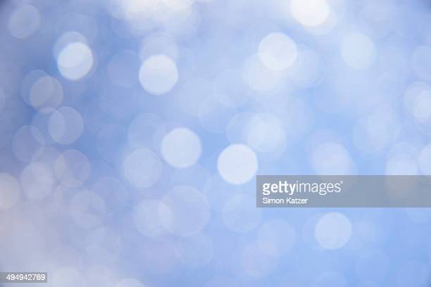 Blue background with bright blurred dots
