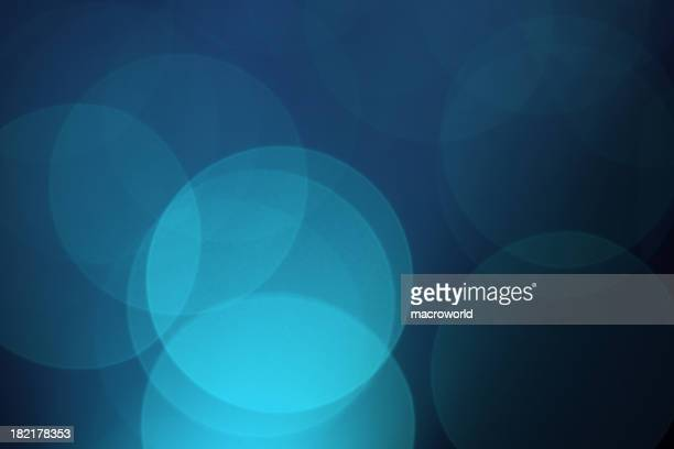Blue background with overlapping circles of shades of blue