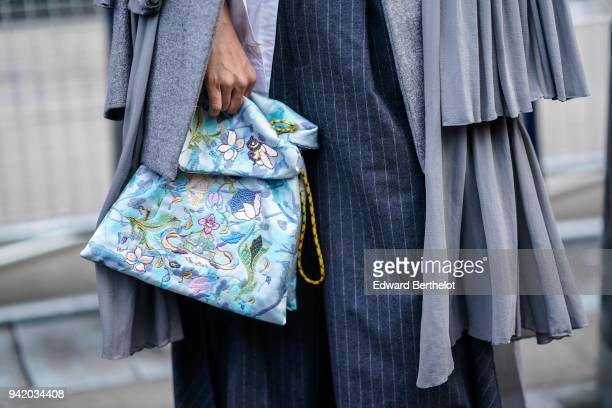 A blue bag with embroidery is seen during London Fashion Week February 2018 on February 16 2018 in London England