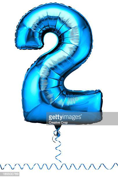 Blue balloon in the shape of a number two