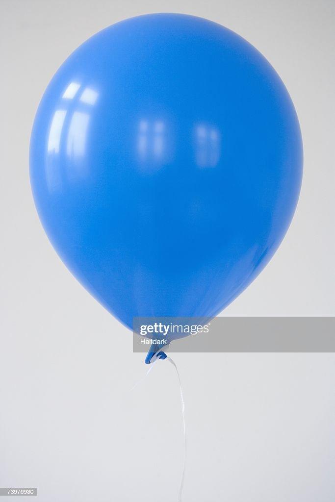 A blue balloon : Stock Photo