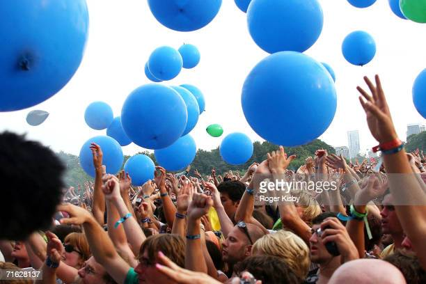 Blue balloons are released during the The Flaming Lips performance at Lollapalooza on August 5 2006 in Chicago Illinois