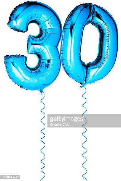 Blue balloons in the shape of a number 30